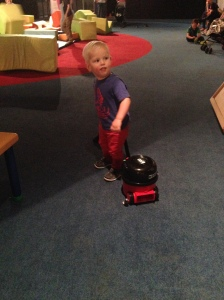 James with the toy Henry vacuum