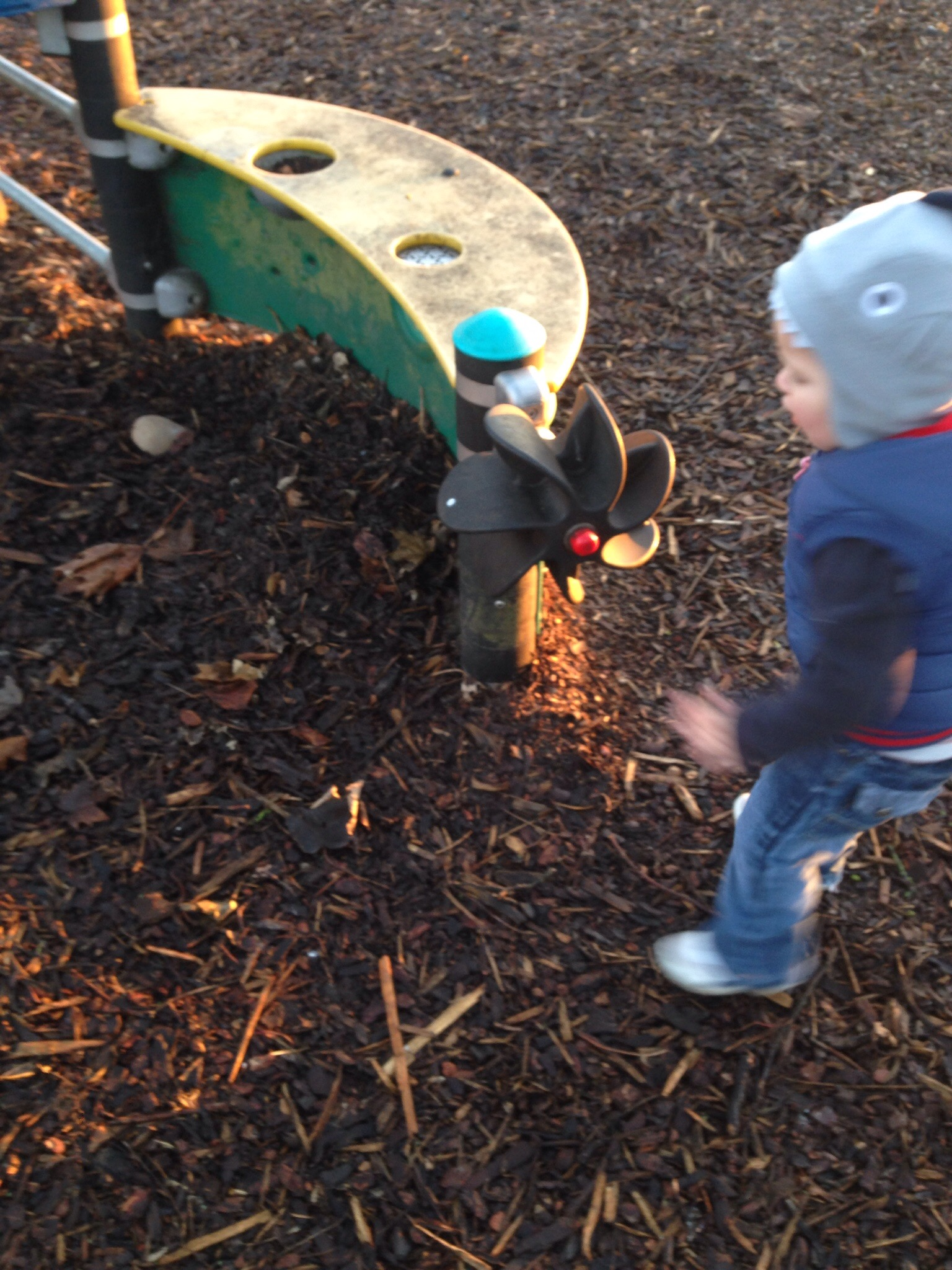 propeller in the park is lots of fun for a toddler