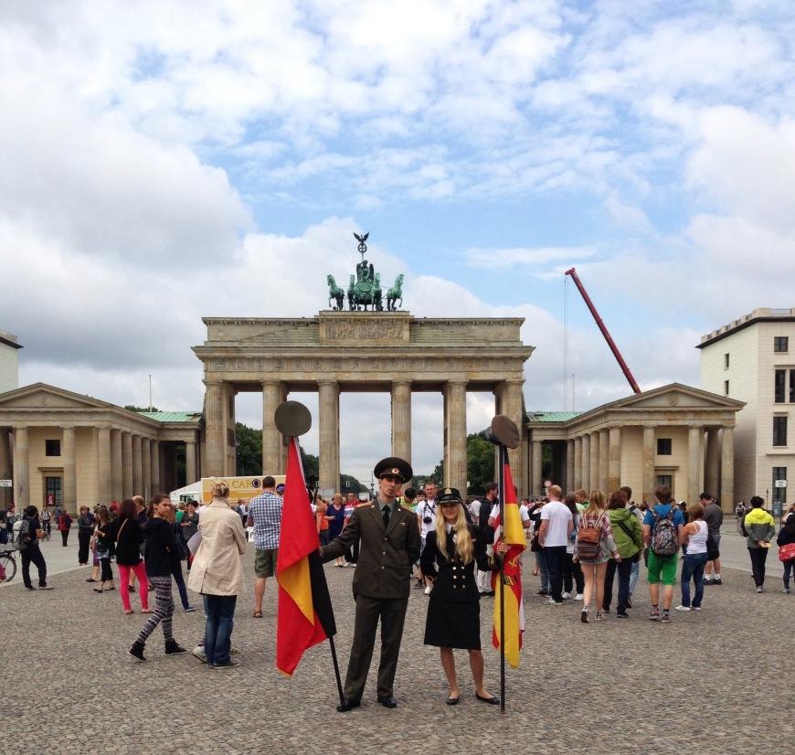 costumed people in front of brandenburg gate