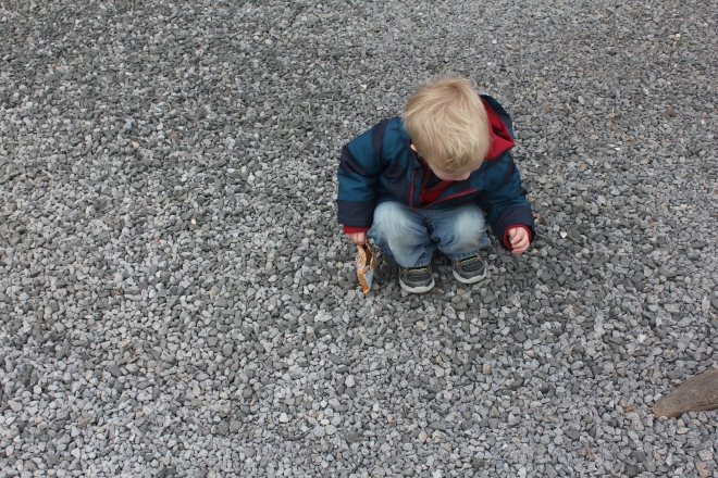 James picking up stones to fill his pockets with at Seaton Delaval Hall