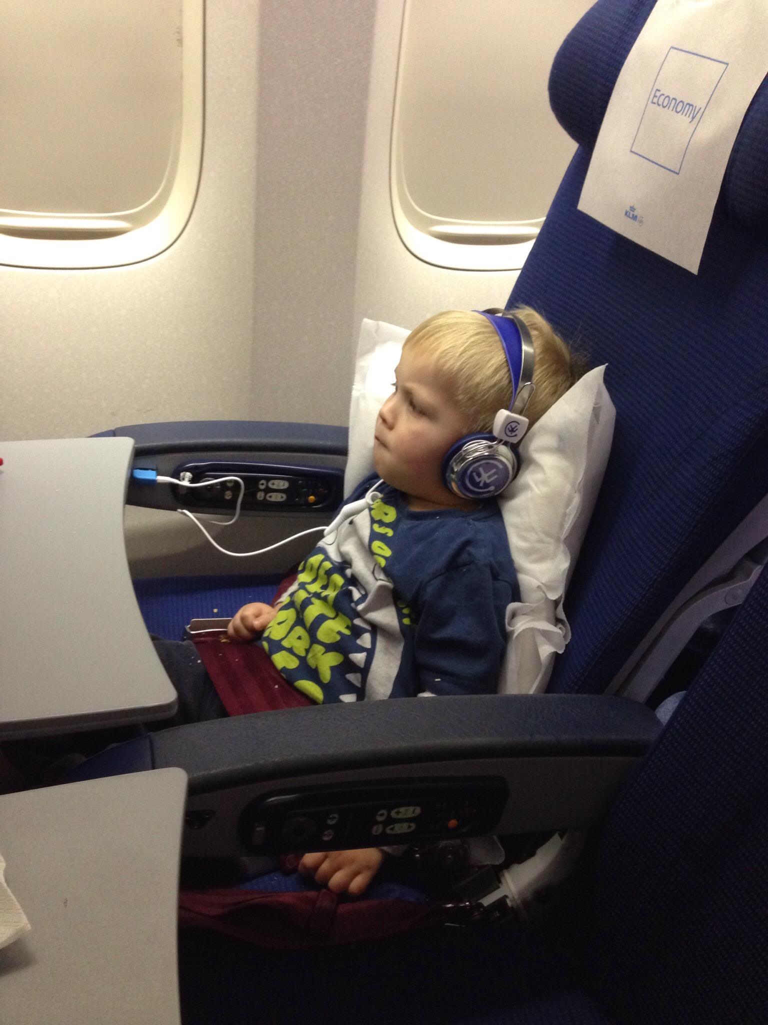 toddler using headphones on an aeroplane