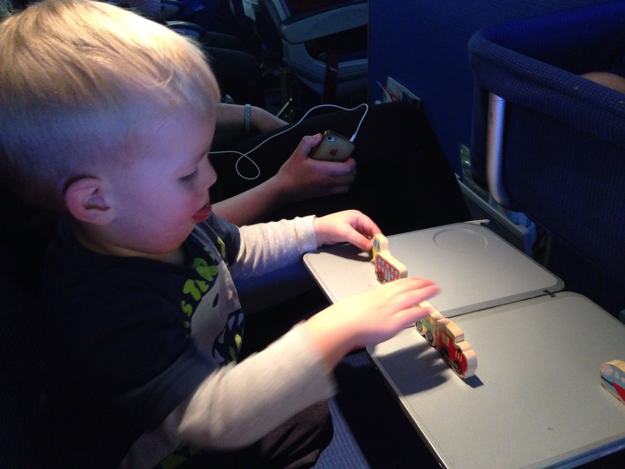 tips to entertain a toddler during a flight - my toddler playing small toys on aeroplane