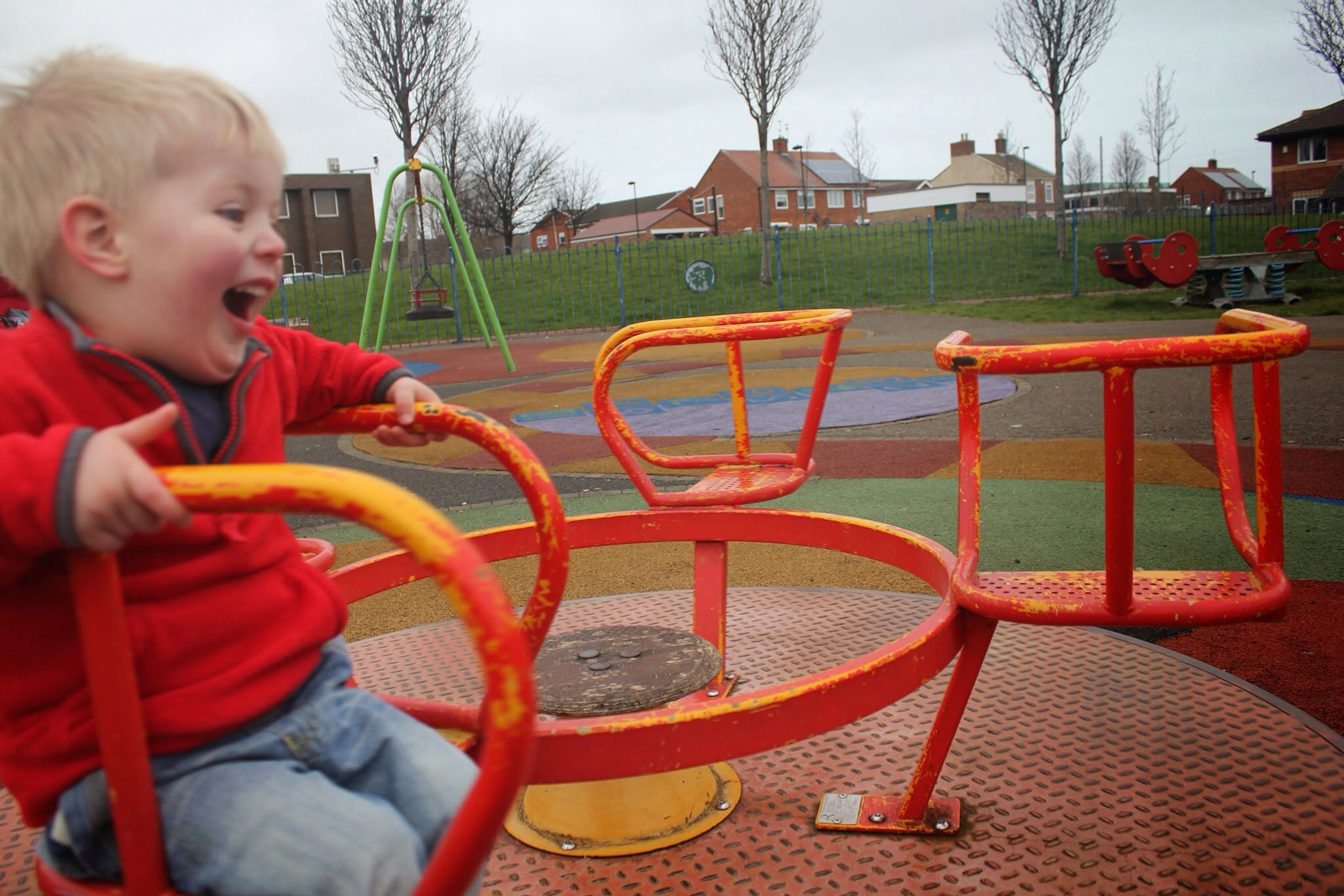 toddler laughing on roundabout pearson park orth shields