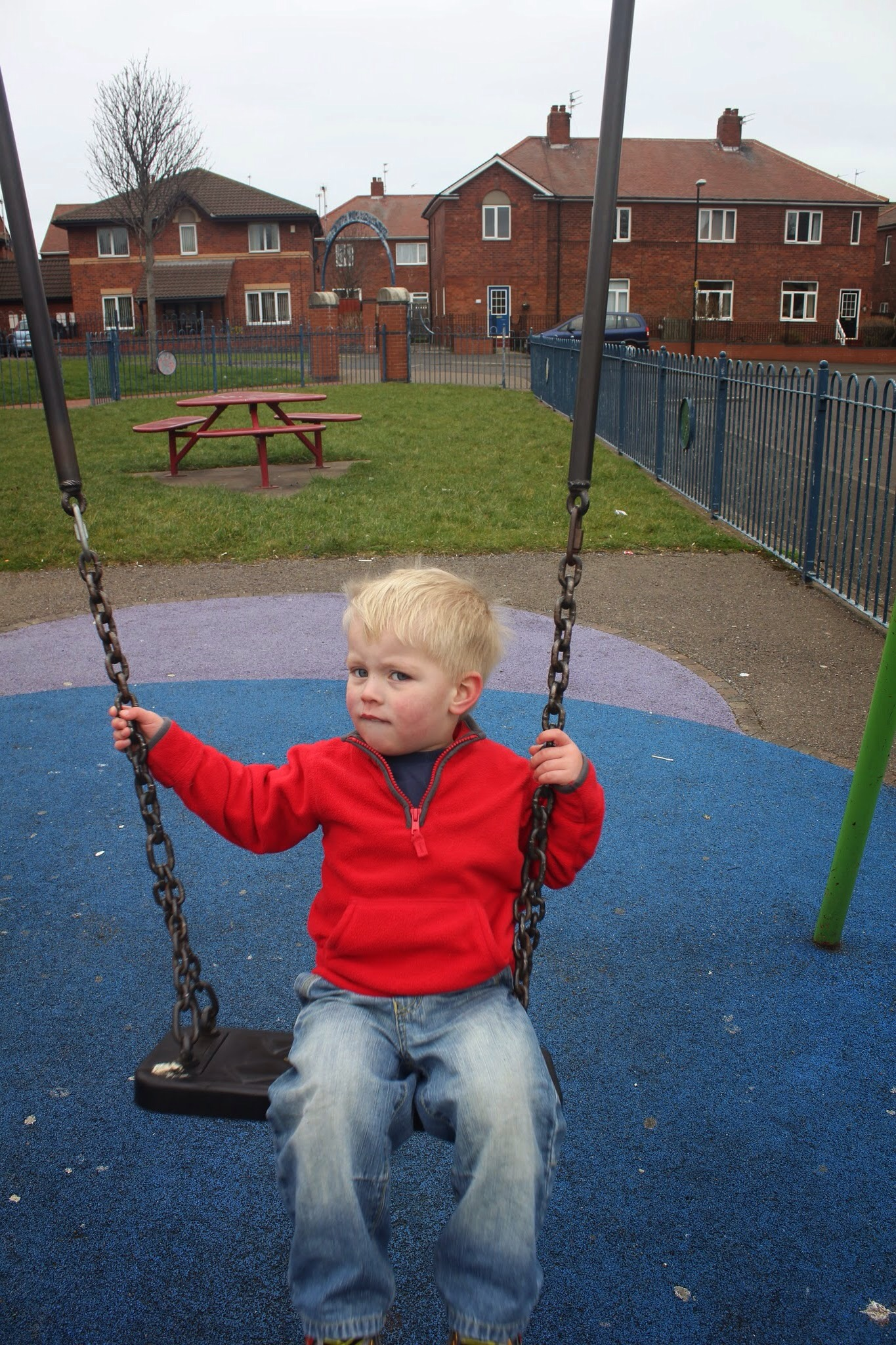 toddler on swing in Pearson Park