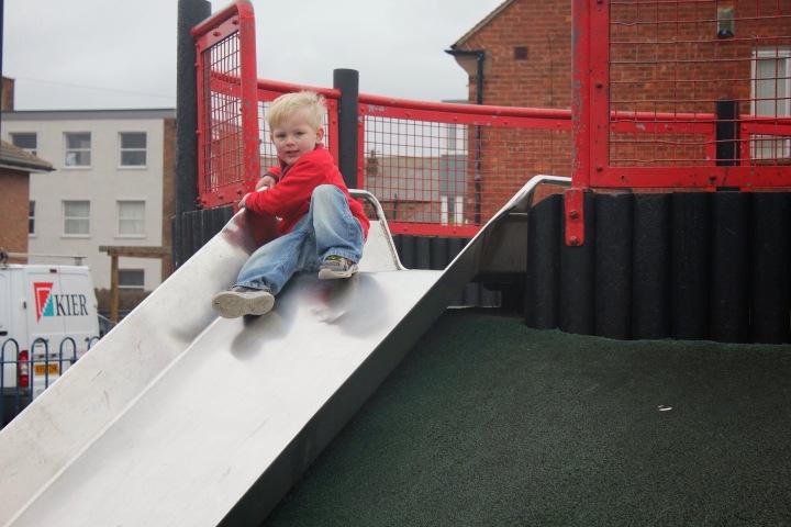toddler on slide at pearson park