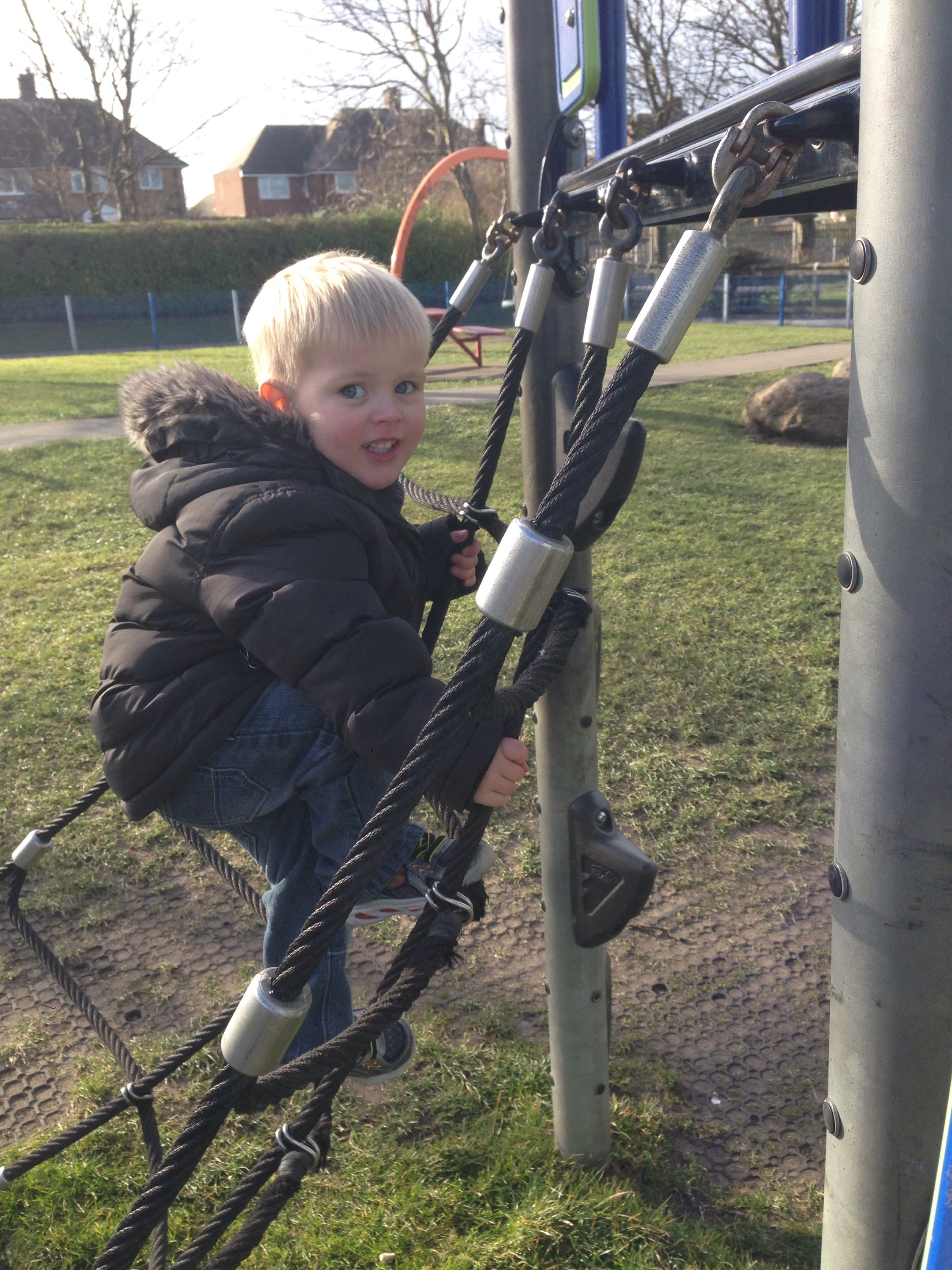 toddler on climbing frame