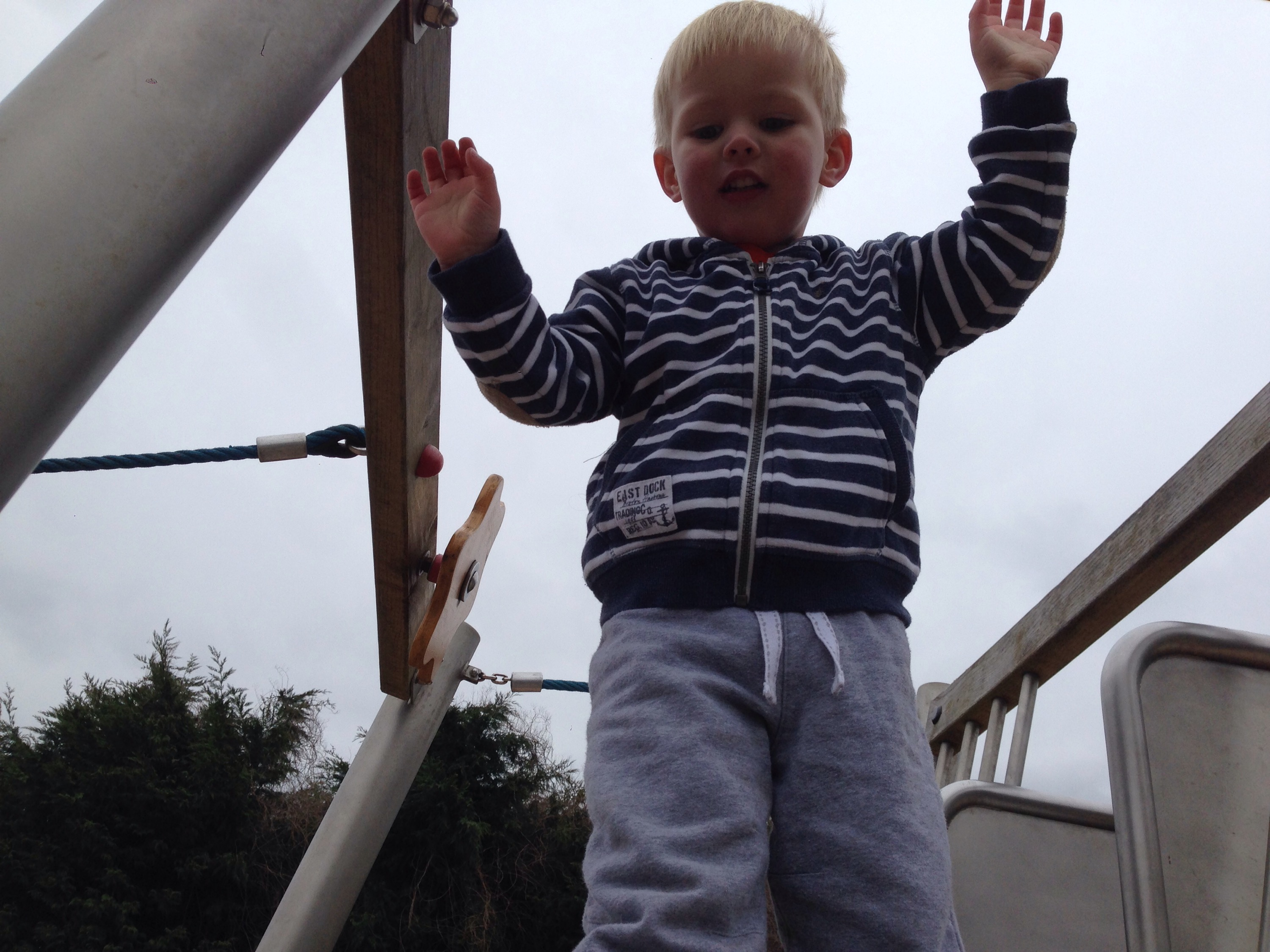toddler at top if climbing frame