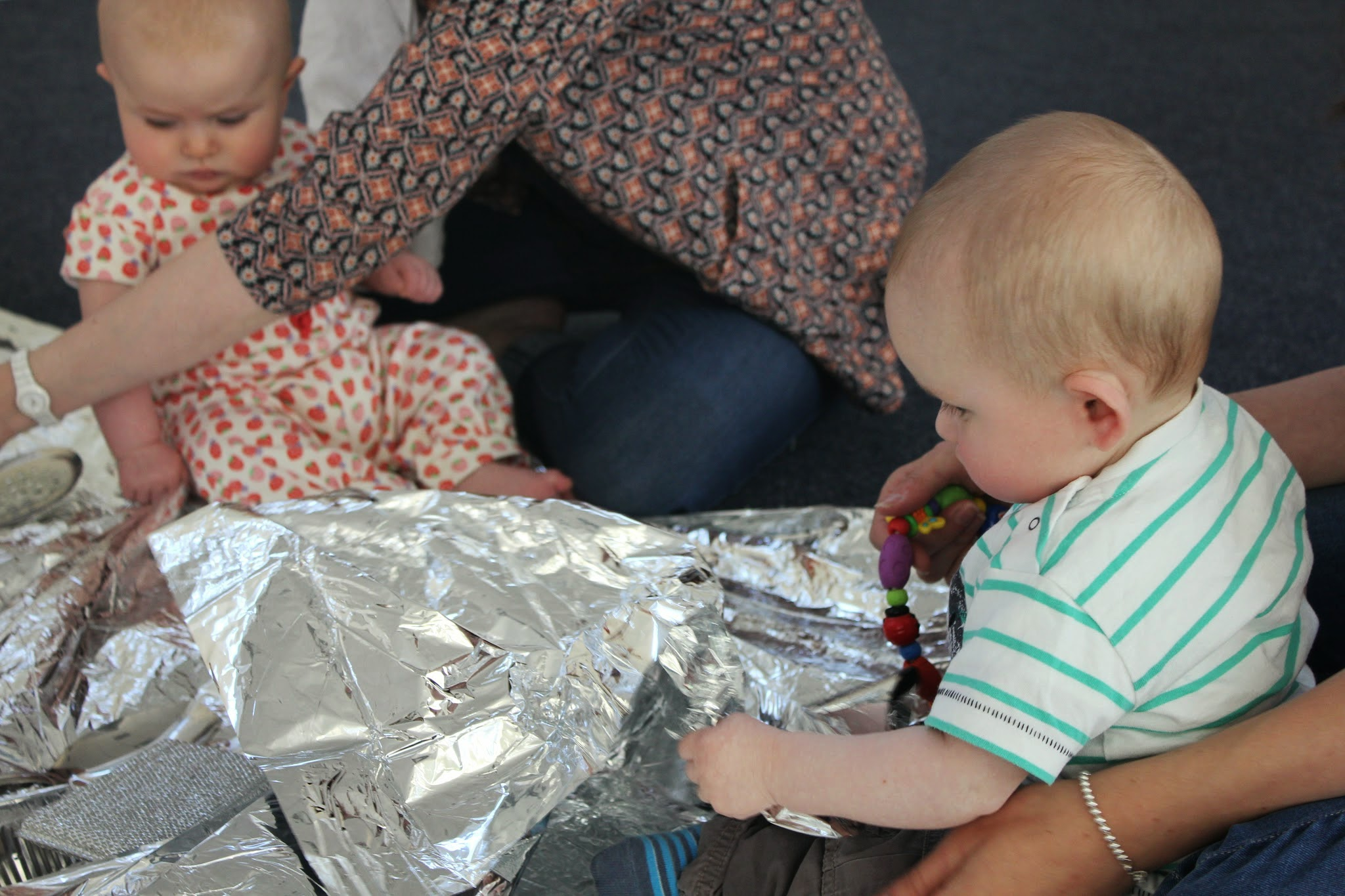 space blanket and babies exploring shiny at tots play north shields