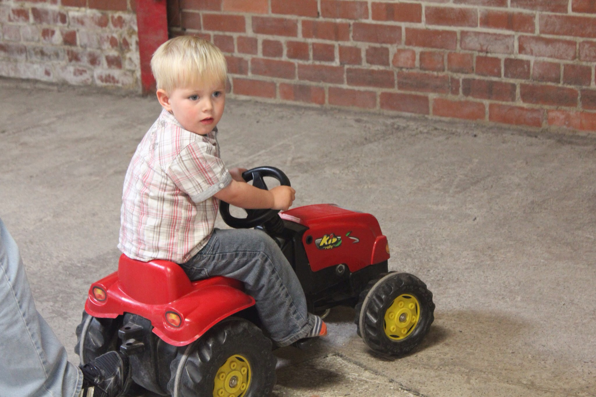 children can ride toy tractors at park hall farm countryside experience