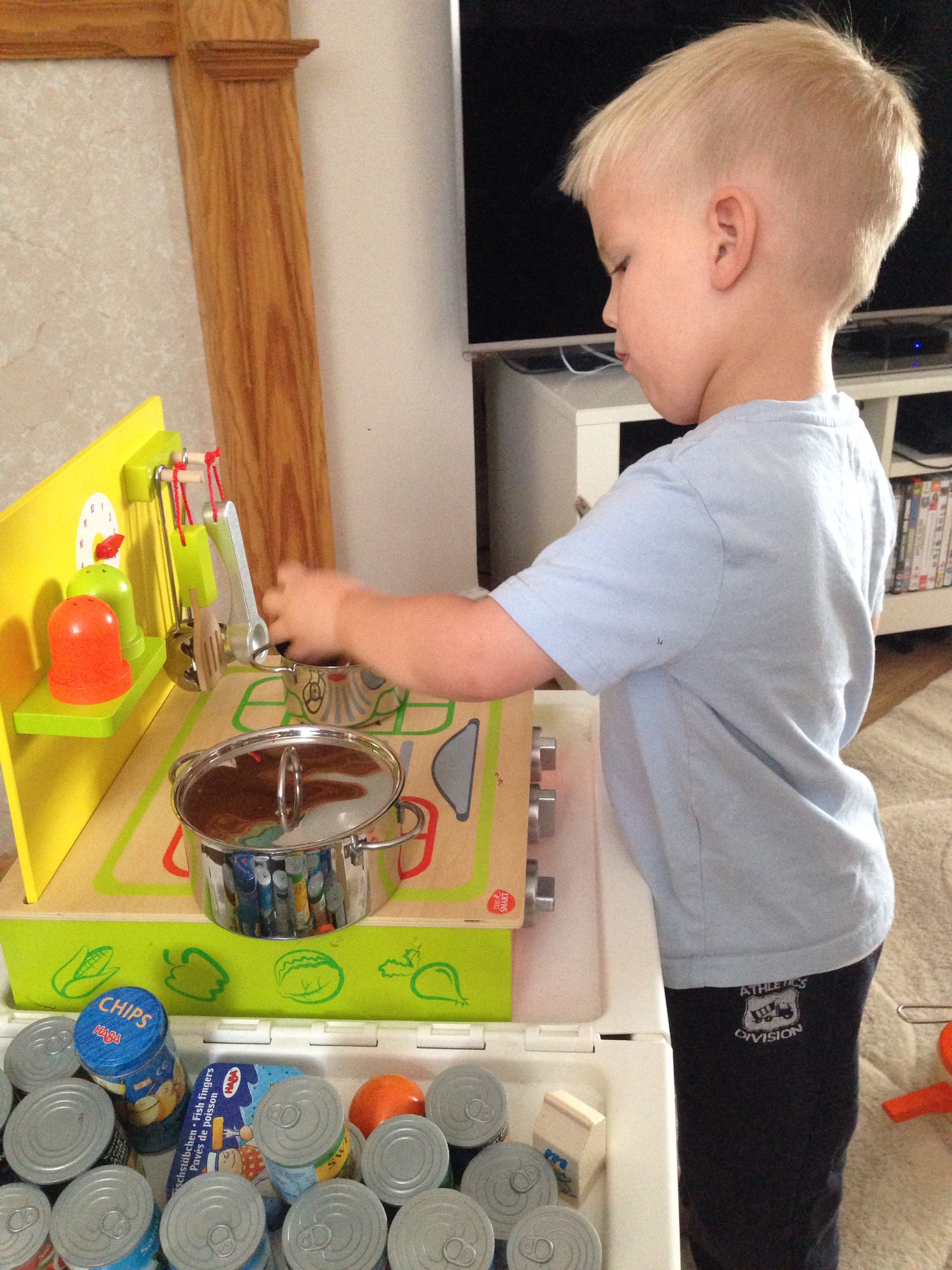 james baking in the toy kitchen
