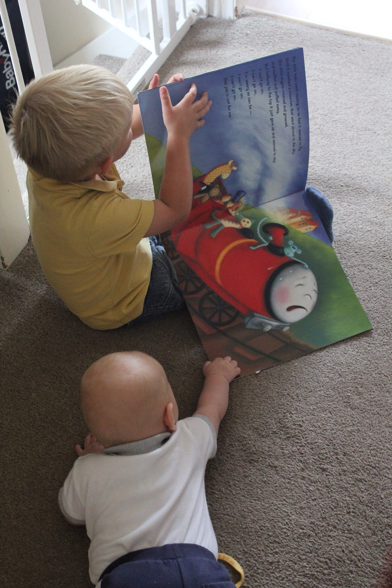 the little engine that could boys reading book babyfoote