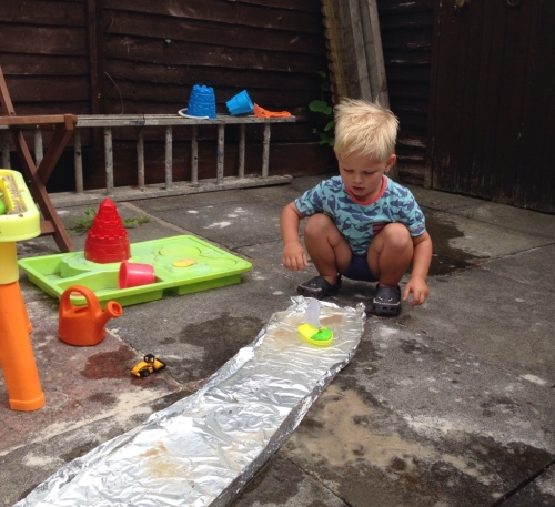 Foil boat toddler activity garden