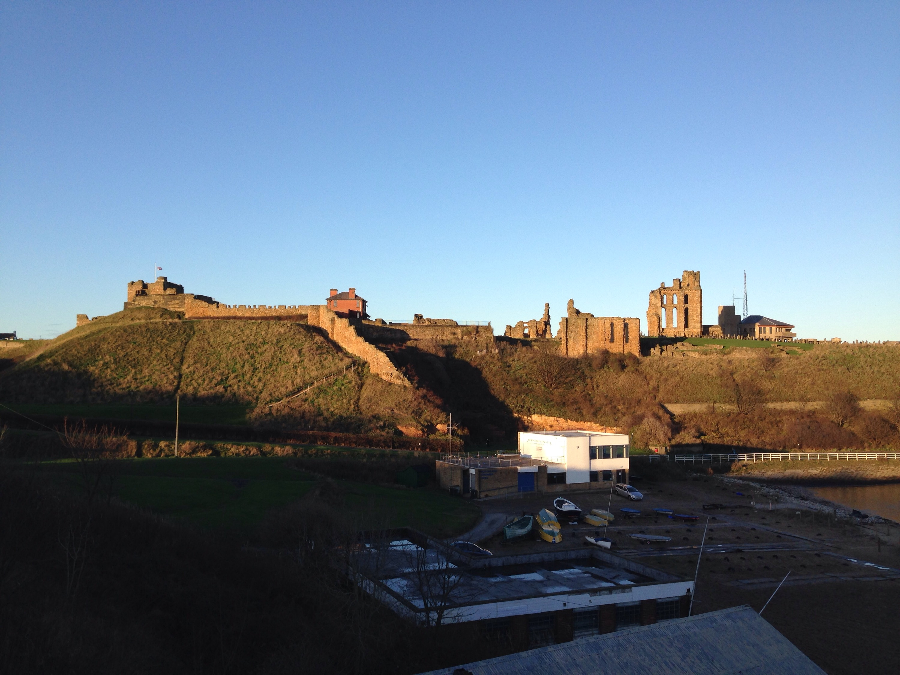 tynemouth priory with sailing club buildings nearby