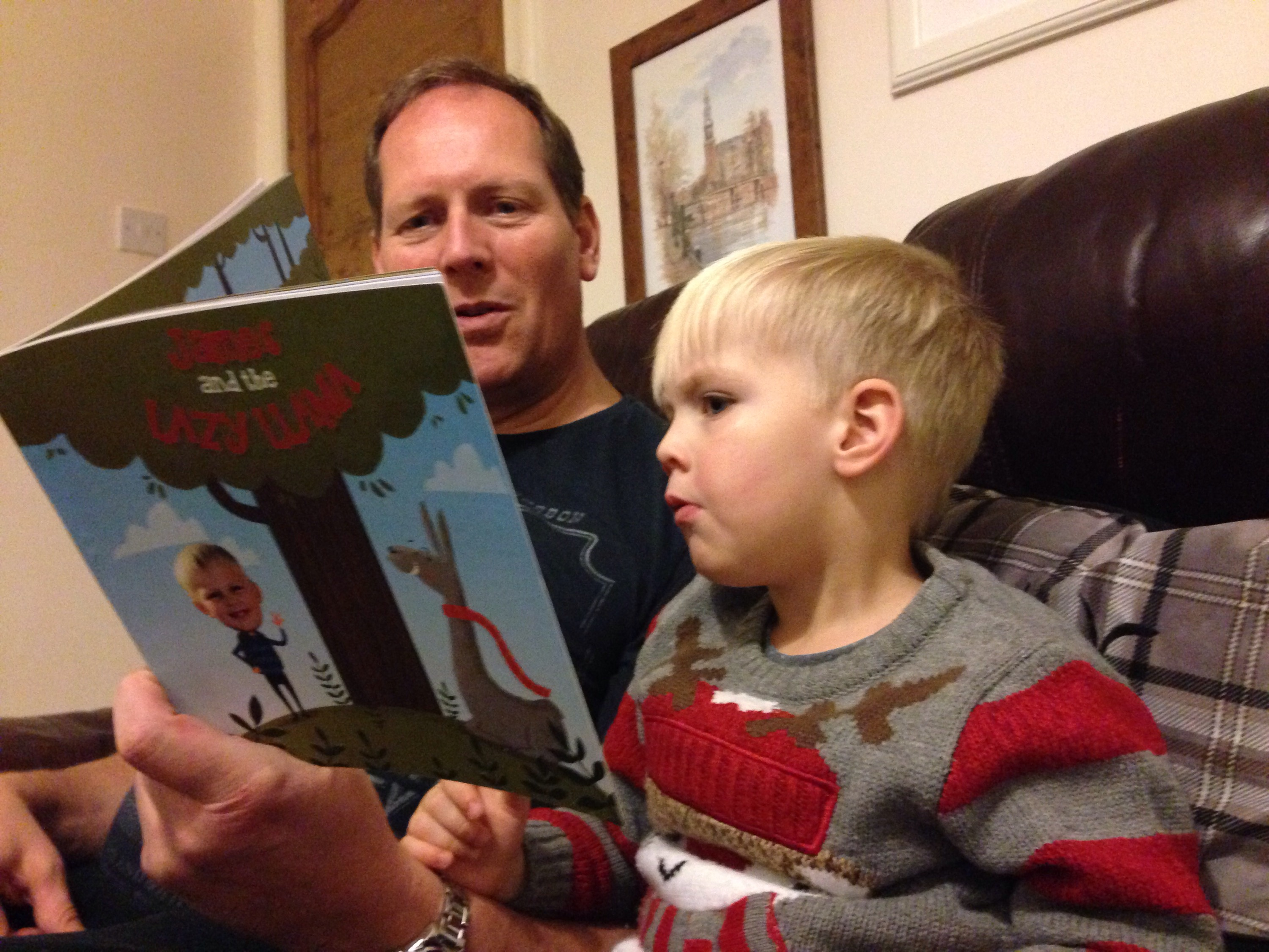 daddy foote and James read the amazing pages book together