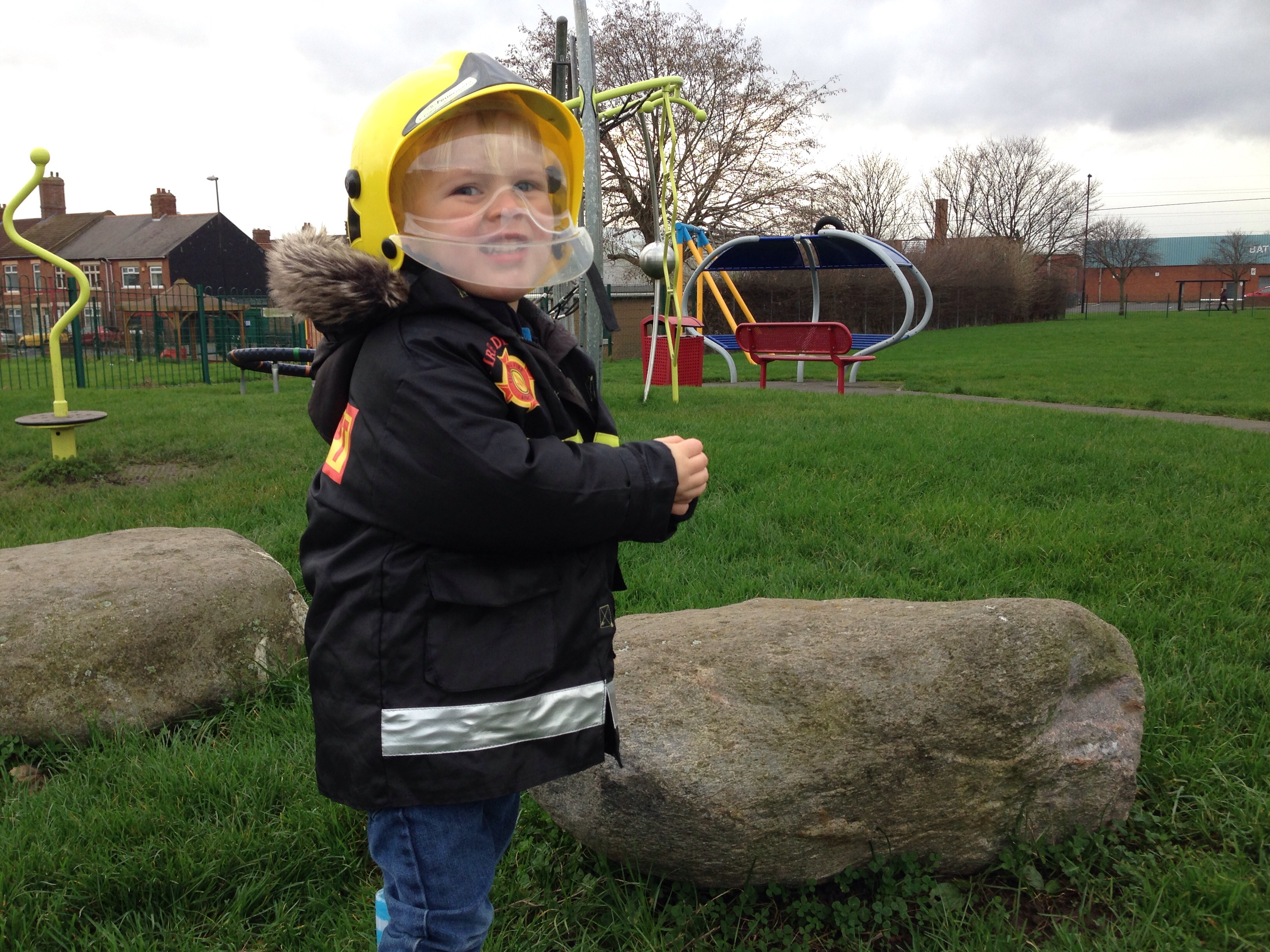 preschooler putting out a fire in the park