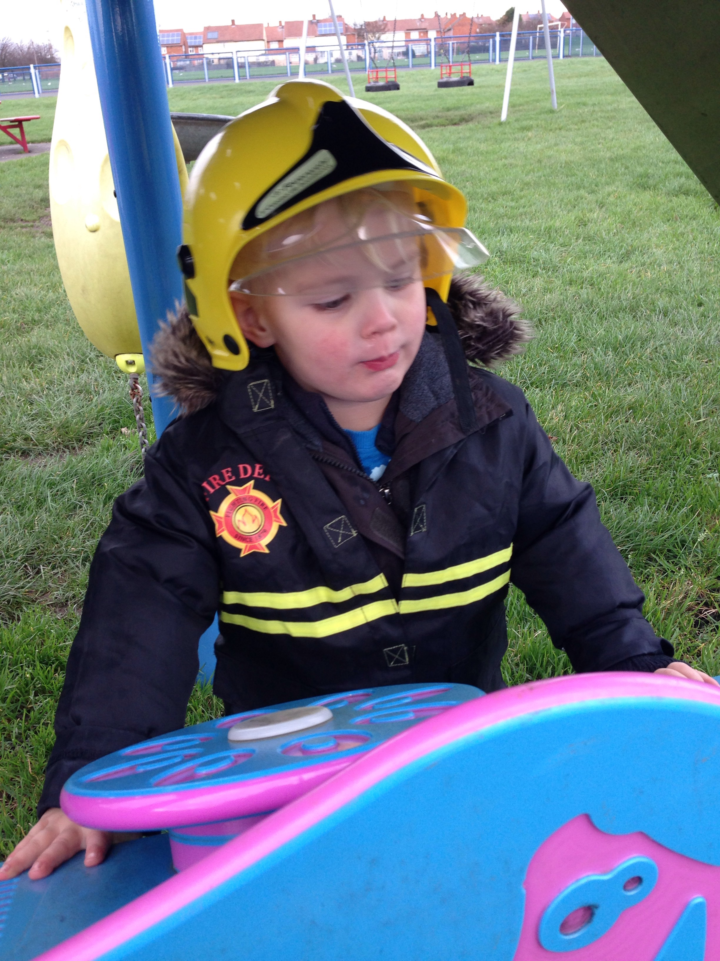checking out his next mission as a fire fighter